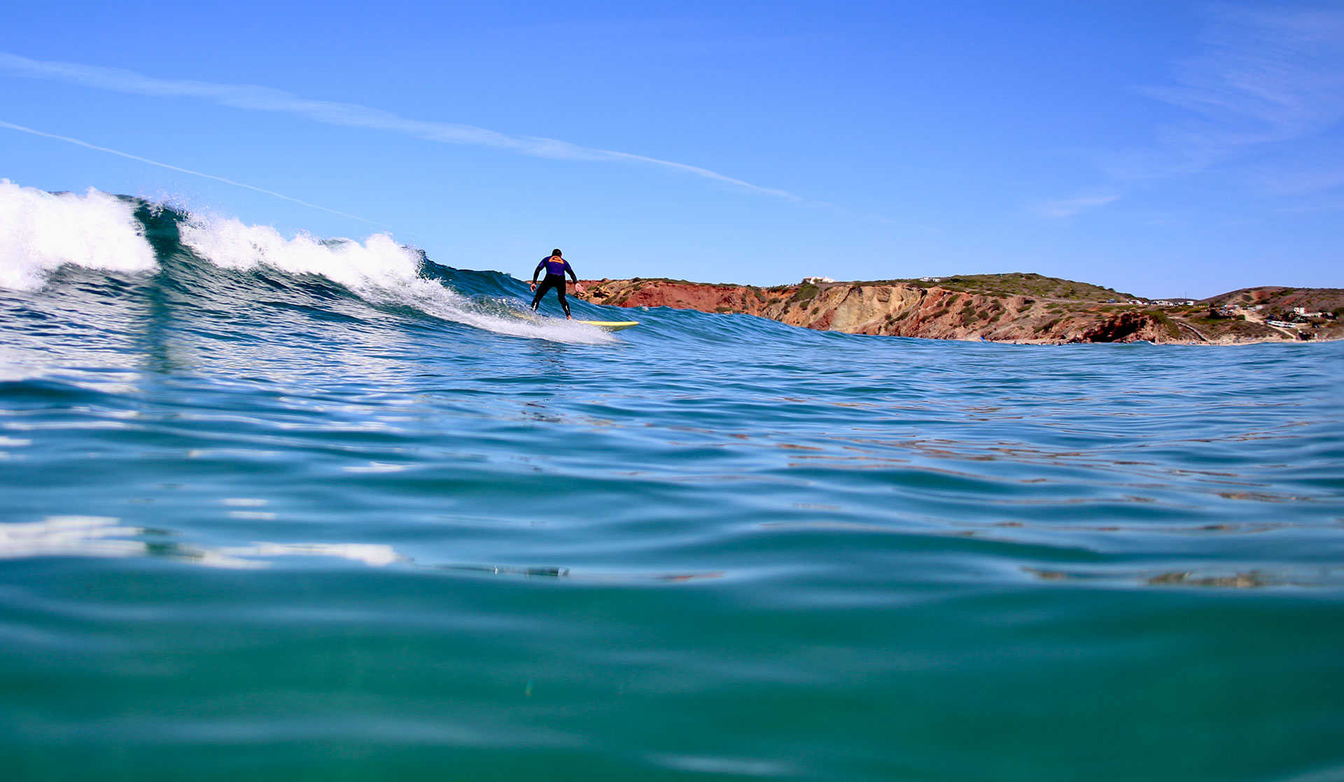 Algarve surfcamp Portugal. You can see our surf school in amado beach at the far right end