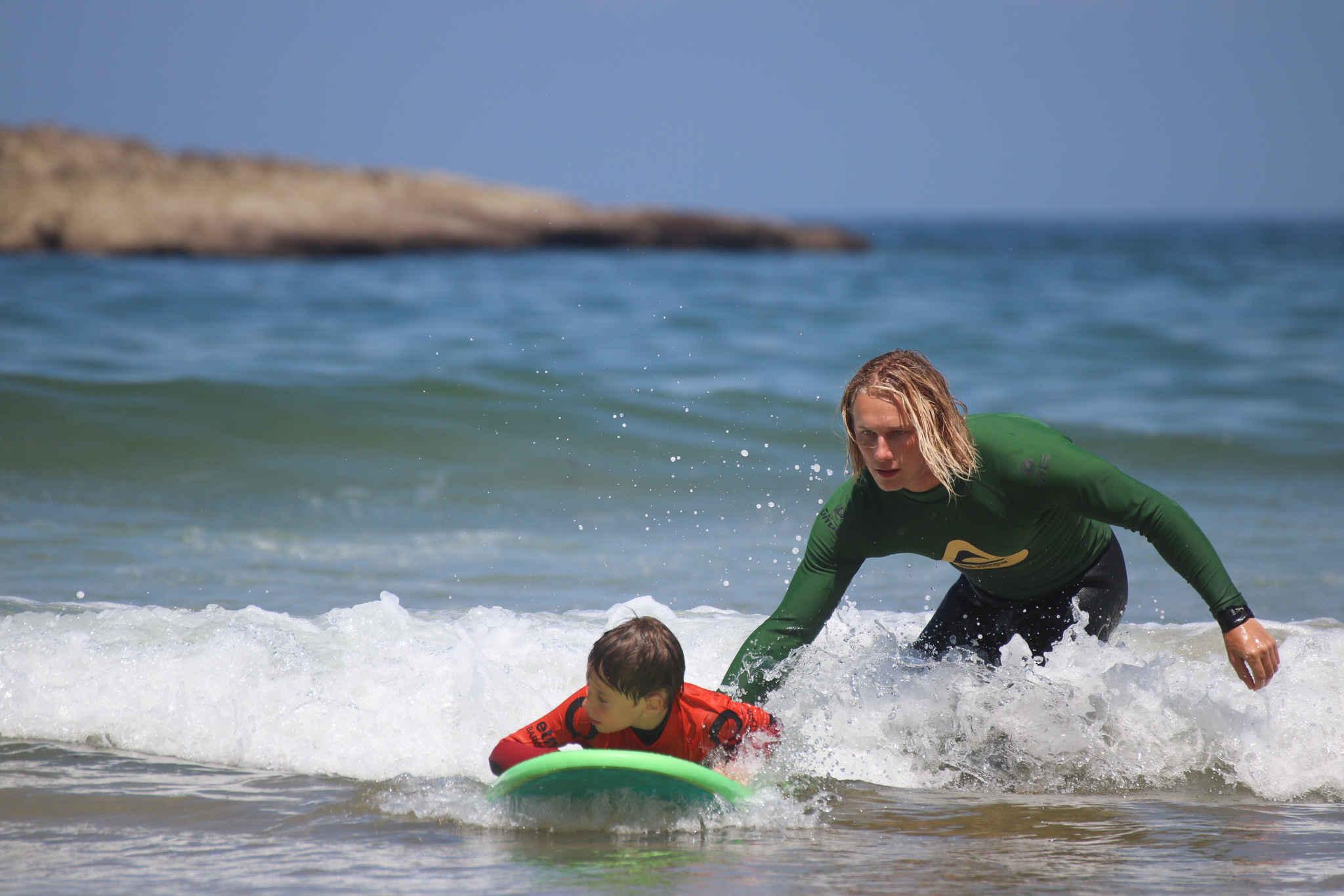 kids having fun algarve surf school portugal amado